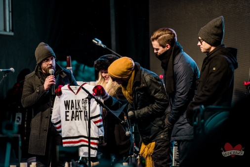 Members of Walk Off The Earth receive Taylor's hockey jersey. They retired the number in honour of Taylor's memory.
